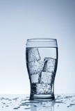 Cold purified water in the glass with bubbles poster