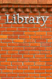 metal library sign on a brick wall background