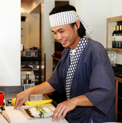 chef makeing sushi