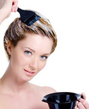 Woman with bowl for hair-dye coloring head poster