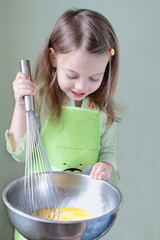 Child Cooking Breakfast