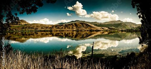 Leinwandbild Motiv Mountains scene with blue sky