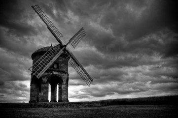 Chesterton Windmill with dark grey clouds and stormy sky