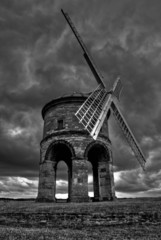Chesterton Windmill, dark grey stormy weather and dark clouds