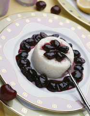rice pudding with stewed black cherries and lemon zests