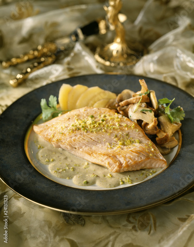 piece of salmon with pistachios,mushrooms and potatoes