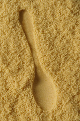 print of a spoon in brown sugar