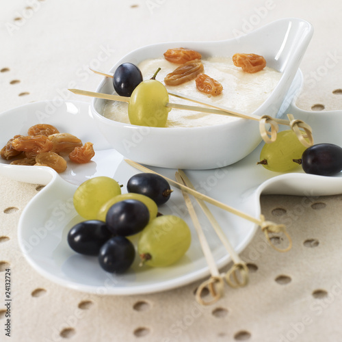 grapes and raisins with a white chocolate mousse dip