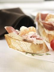 serrano ham ,boiled ham,shrimp and goat's cheese on a bite-size slice of bread