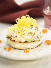 king crab,mayonnaise,lettuce and egg on a bite-size slice of bread