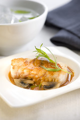 small casserole dish of grouper with urchin sauce