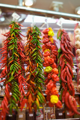 peppers hanging in a store