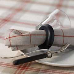 plate,knife and fork,napkin and glass