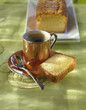 cup of coffee and a slice of orange-flavored sponge cake