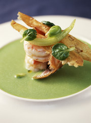 pan-fried dublin bay prawns,almond croquant and watercress and broad bean sauce