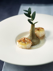 pan-fried dublin bay prawns and poivrade artichoke with eucalyptus broth