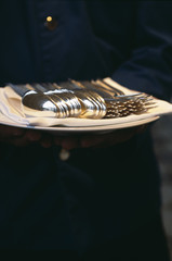 silver cutlery on a tray