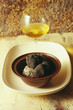 black truffle and glass of white wine