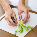 cutting a spring onion