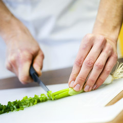 cutting a spring onion into thin slices