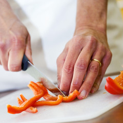 cutting a red pepper into thin strips