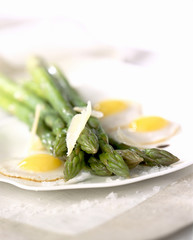 green asparagus with fried quail eggs and parmesan flakes