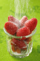 powdering strawberries with sugar