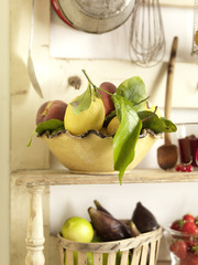 bowl of fruit on kitchen shelves