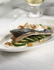 trout with zucchinis and thinly sliced almonds