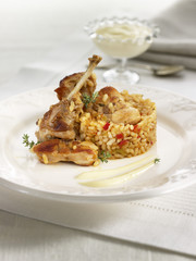 rabbit cooked in a saucepan with rice