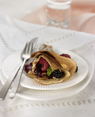 rolled pancake filled with summer fruit