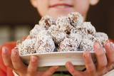 chocolate truffles coated with grated coconut