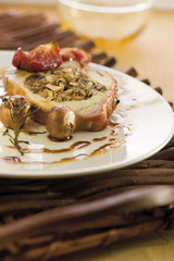 pork backbone stuffed with prunes,tomatoes and pine nuts