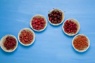 small baskets of summer fruit