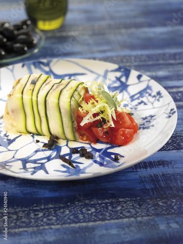 thinly sliced zucchinis stuffed with goat's cheese and tomatoes