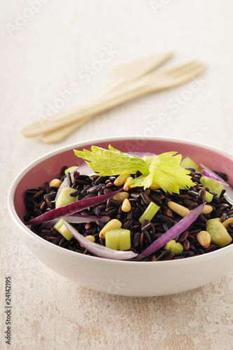 brown and wild rice with chopped celery stalks
