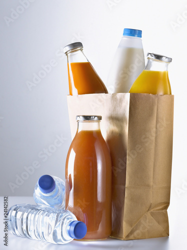 bottles in a brown paper bag