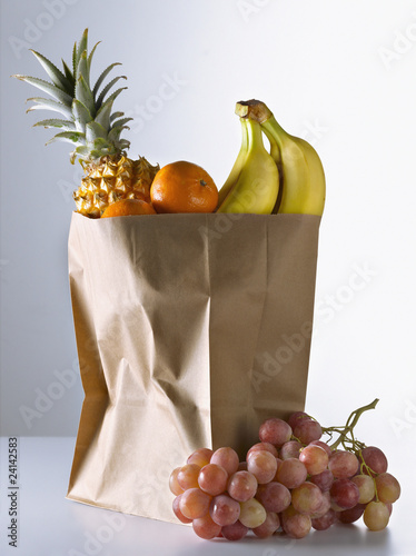 fruit in a brown paper bag