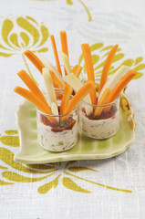 raw carrots and fennel with dip sauces
