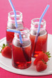 small bottles of strawberry cordial