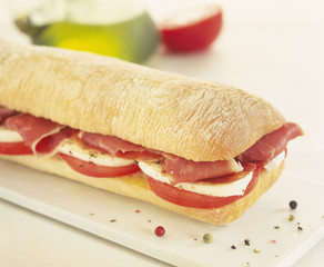 tomato,mozzarella and raw ham ciabatta bread sandwich