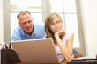 Angry Father And Teenage Daughter Using Laptop At Home