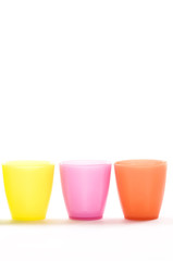 Plastic cups of various colours isolated