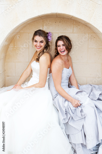 Young Women in Gowns and Sitting in an Alcove
