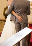 Bride and Groom at the Alter in Church poster