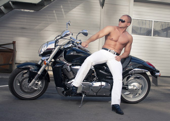 Shirtless caucasian biker