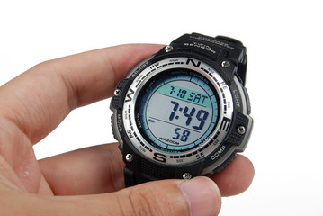 holding a wristwatch
