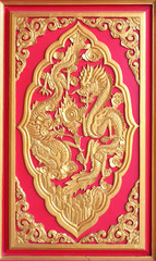 Double golden dragon in chinese style. On red wood.