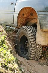 4x4 off-roader tyre stuck in rut