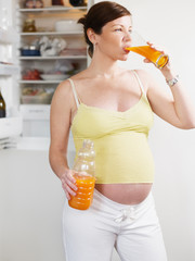 pregnant woman with juice